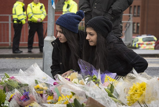 Mourners lay flowers at the scene of Mr Shah's death last month. He advocated peace between religions