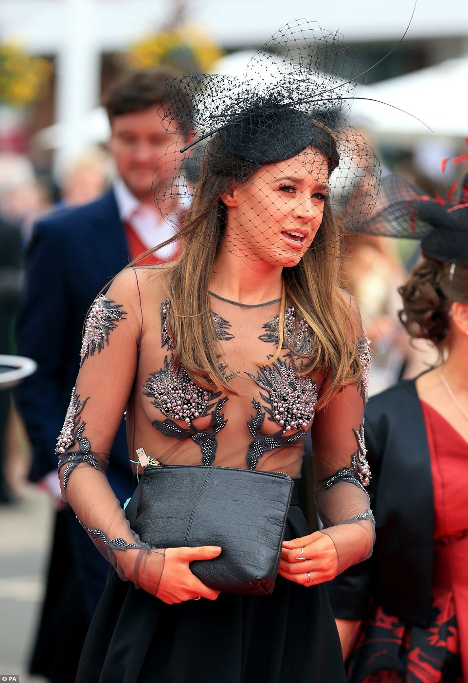A woman made a brave fashion choice in a sheer top with strategically placed embellishments to protect her modesty