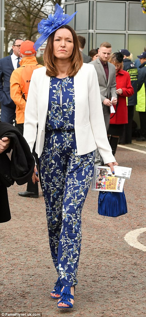 A pretty floral jumpsuit with a fringed bag and heels was a striking look