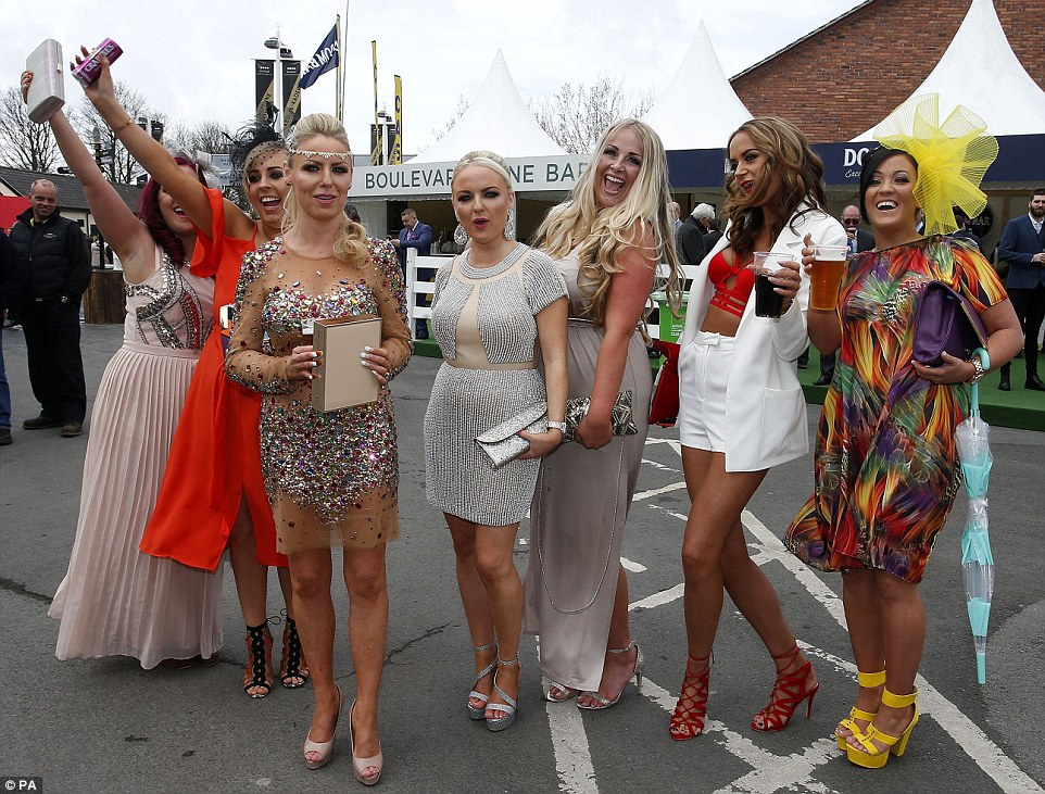 Kicking off the celebrations: A group of friends made for an eye catching party in sparkly outfits and lots of colour
