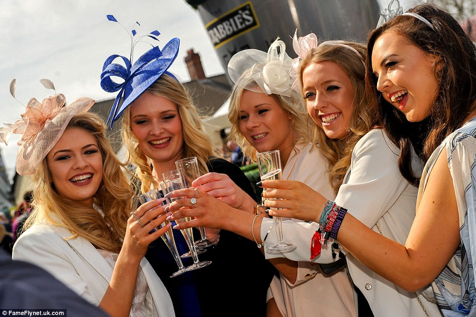 Here's to a great day: The champagne was flowing as the racing action got underway