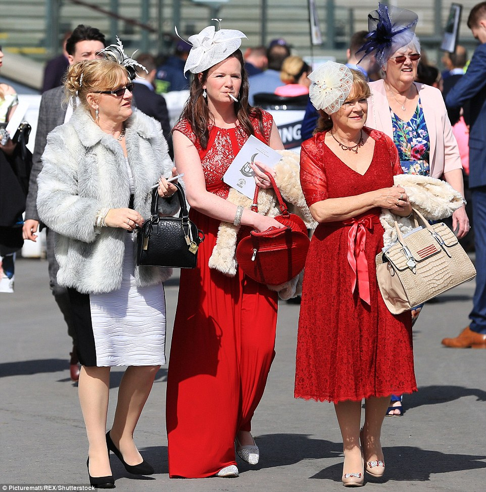 A party of friends were resplendent in red with one completing her look with a heart shaped handbag (centre)