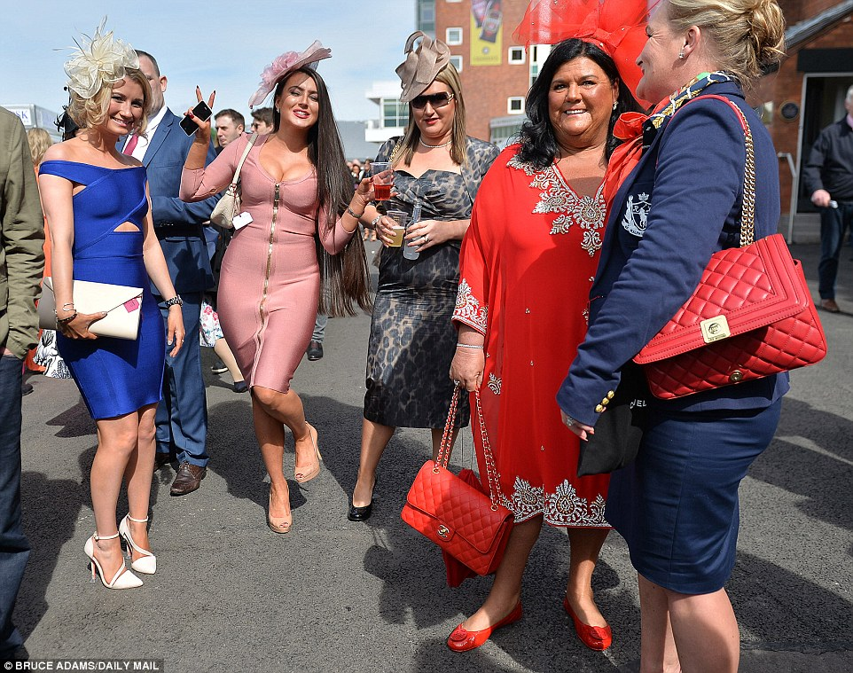 A fashionable bunch showed off their Chanel handbags as they celebrated at Ladies Day