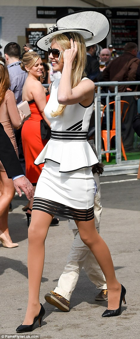 A racegoer looked stunning in an elegant black and white ensemble and took the rare step of wearing flesh coloured tights rather than going bare legged