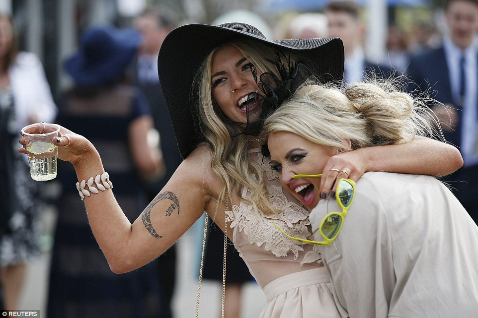Two friends were clearly having fun at the event, which seemed to be a good deal more boozy than yesterday's gathering