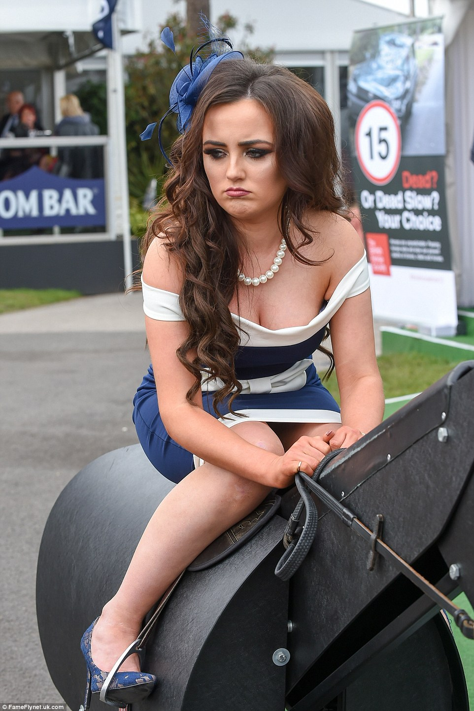 A woman looked slightly disgruntled as she did her best jockey impression on a mechanical horse