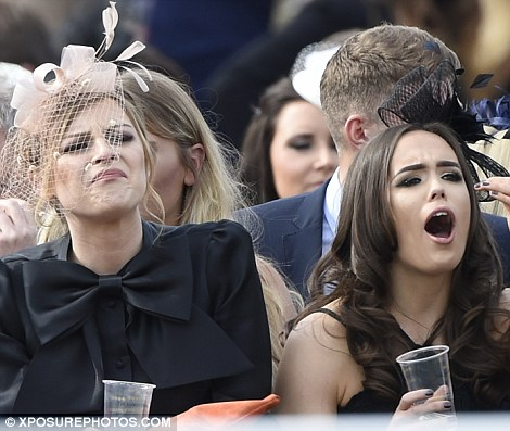 Agony And Ecstacy At Aintree: Racegoers look disappointed when their favourite horses failed to romp to victory