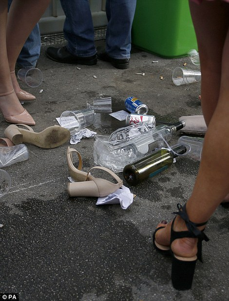 Shoes were left discarded on the ground alongside drinks cans