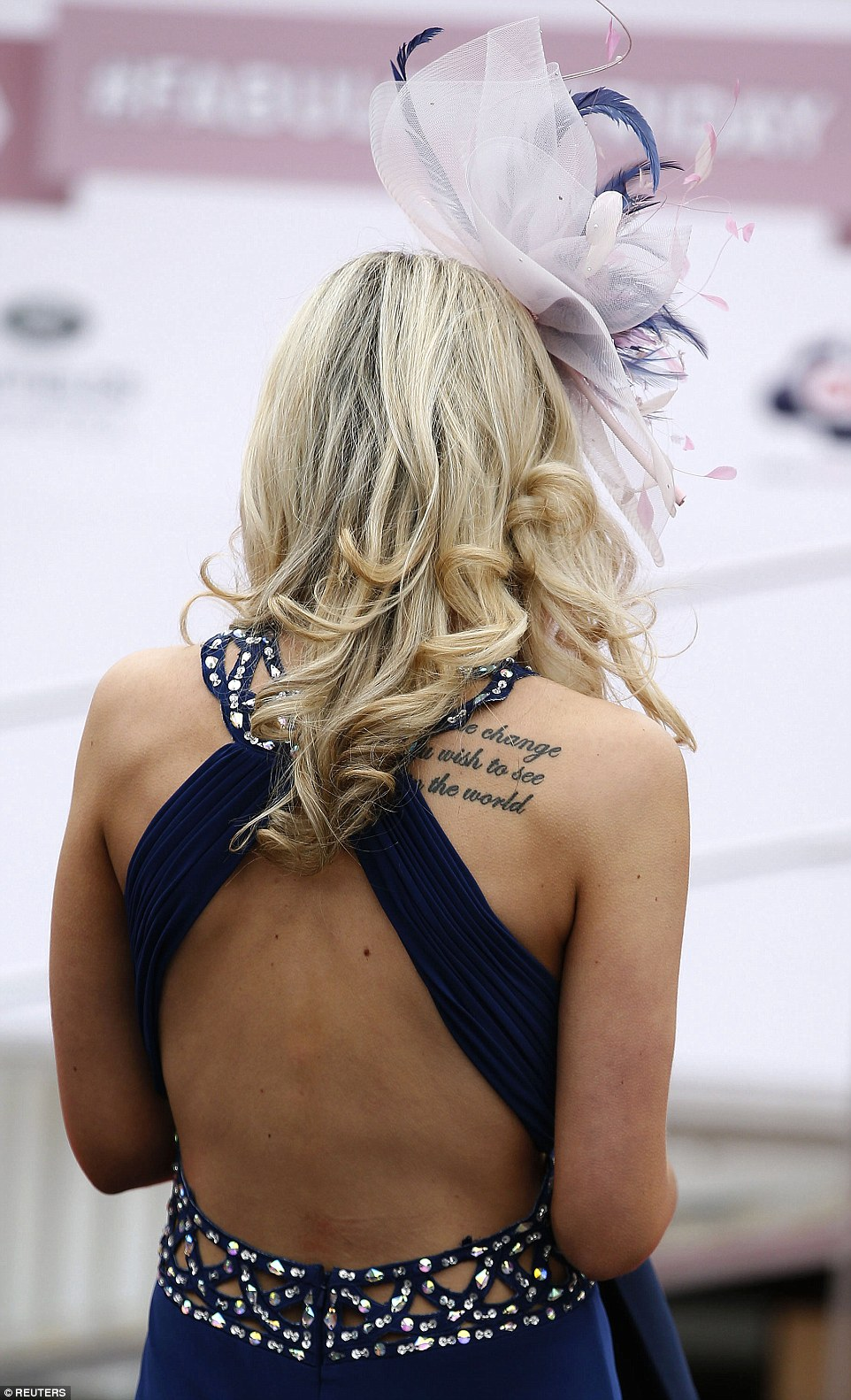 A woman displays her tattoo of Mahatma Gandhi's famous words: 'Be the change you wish to see in the world.'