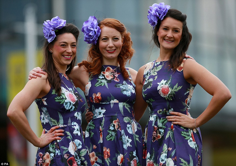 A trio in matching floral dresses, wearing horseshoe necklaces, looked delighted to be attending the second day of the festival