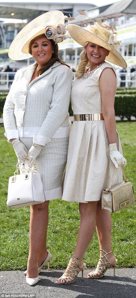 Two friends showed odd their ladylike chic in demure gloves and statement hats