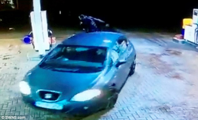 Driven off: The car the victim fell against leaves the scene of the attack in Birmingham on Saturday morning