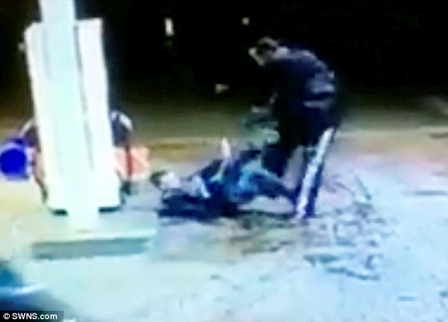 The victim is kicked and punched repeatedly by his attackers while he holds his hands up begging them to stop