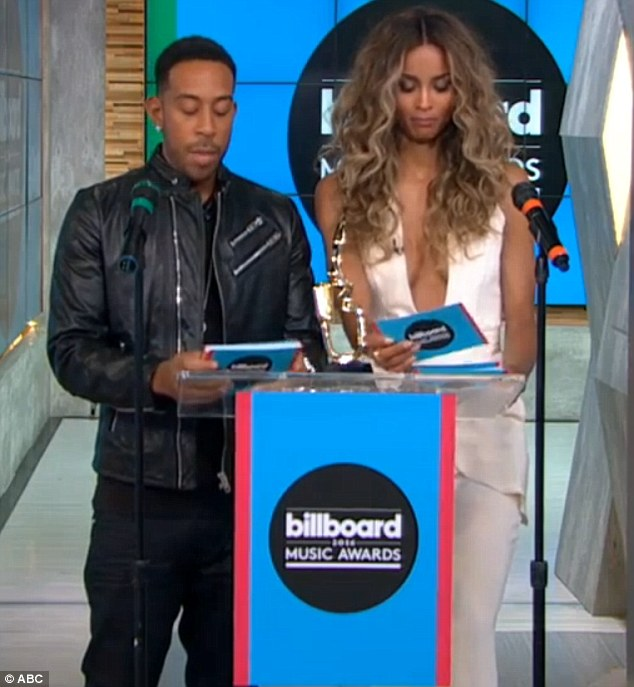 Awkward: Ciara was not best pleased when she saw ex-lover Future's name on her card as she announced thetop rap artist category for the Billboard Music Awards on Monday