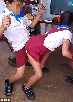 A controversial video (pictured) showing young children in school uniforms dancing provocatively and twerking has been posted online