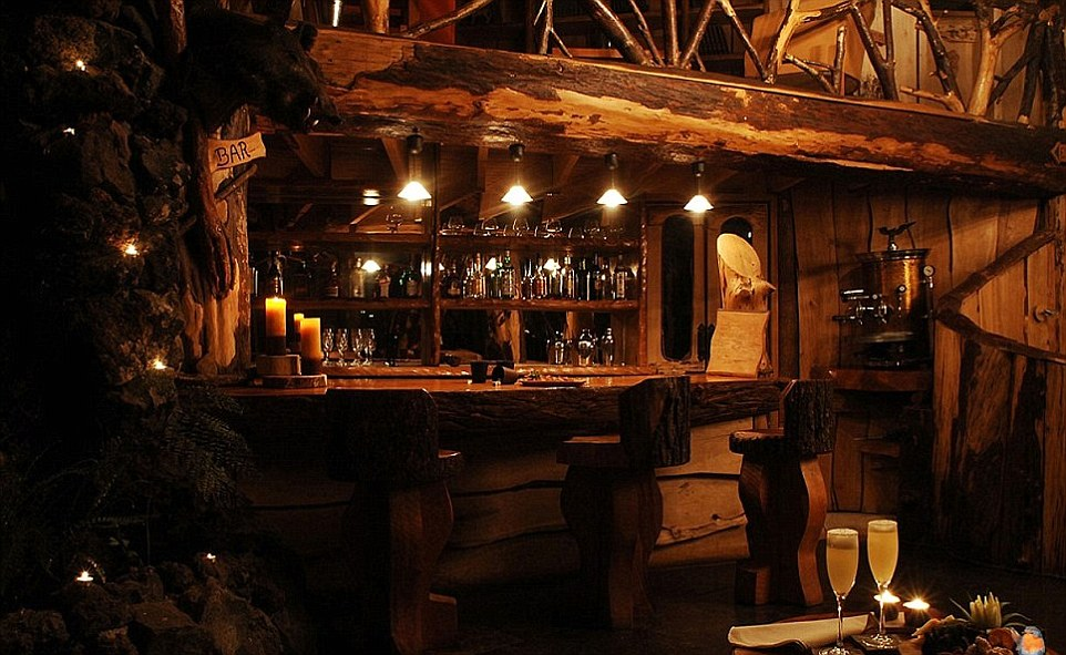 The bar and restaurant inside are just as beautiful as the exterior, with its all-natural wood and stone decor
