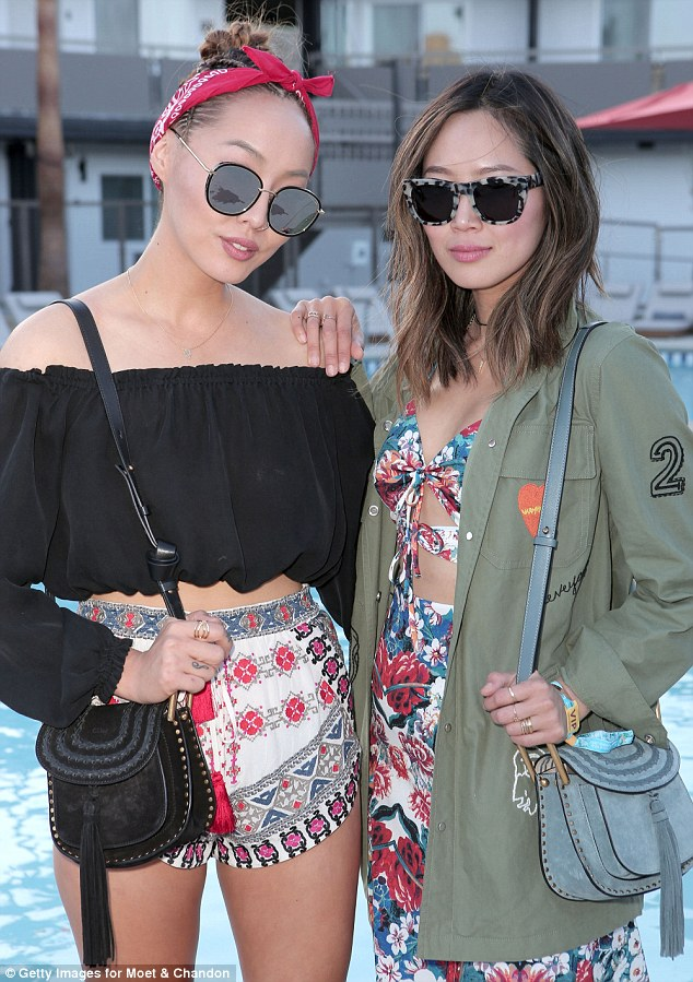 Prepared: Style bloggers and sisters Dani and Aimee Song attended an early evening pre-party in their Coachella gear that mixed bold colors and patterns and each had the de rigueur cross-body shoulder bag