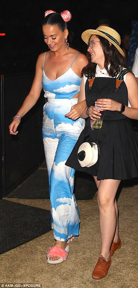 Katy Perry took a break from her PDA with Orlando Bloom to don a colourful, cloud-print jumpsuit
