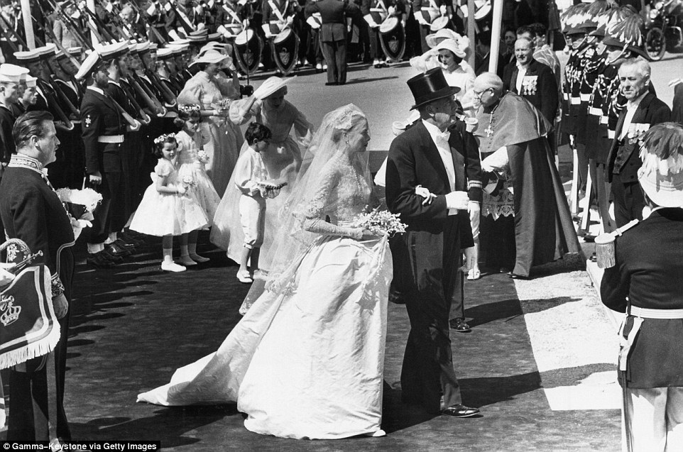 The big day: Kelly's arrival at the Cathedral was accompanied by all the pomp and circumstance one would expect for a princess
