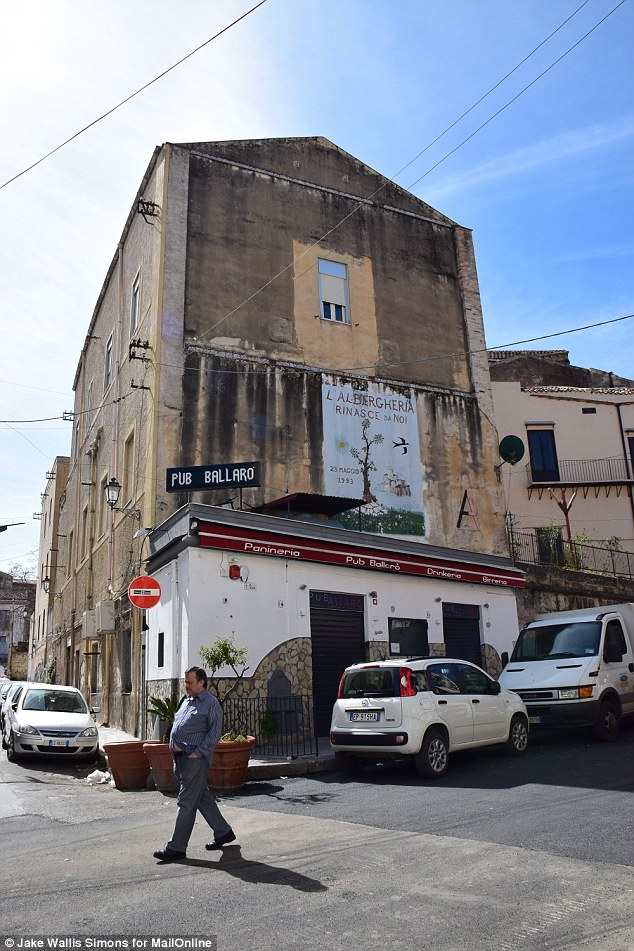 Trigger:The current round of violence began last month, when the Mafia-owned Pub Ballaró (pictured),  was seized by police and handed to legitimate entrepreneurs
