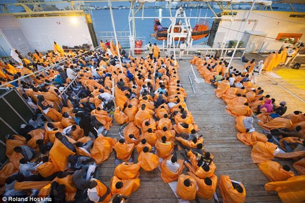 Arrivals: 900 migrant men pictured on a boat in the port of Palermo, Sicily. The immigrant population in the area has risen from five to 25 per cent since the beginning of the crisis