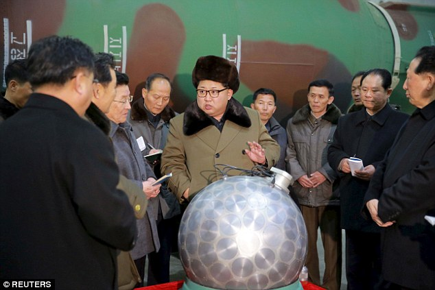 Last month North Korean state media published this image of Kim Jong-un standing beside what it claimed was one of its first miniaturised nuclear warheads
