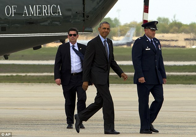 Obama, accompanied by the Commander of 89th Airlift Wing Colonel John Millard, walks to board Air Force One on the way to Saudi