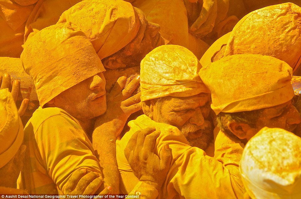 Devotees covered in turmeric carry the sedan chair of Shiva at the Khandoba temple in Jejuri, India, on Somvati Amavasya, a no moon day