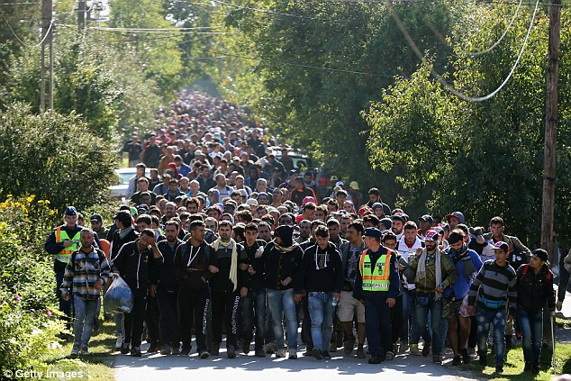 According to local media, the woman had been advised that because of her age, there was a limited chance of success - but the pair insisted on going ahead with the attempt. File picture: Hundreds of migrants arriving at the Hungarian and Austrian border last year