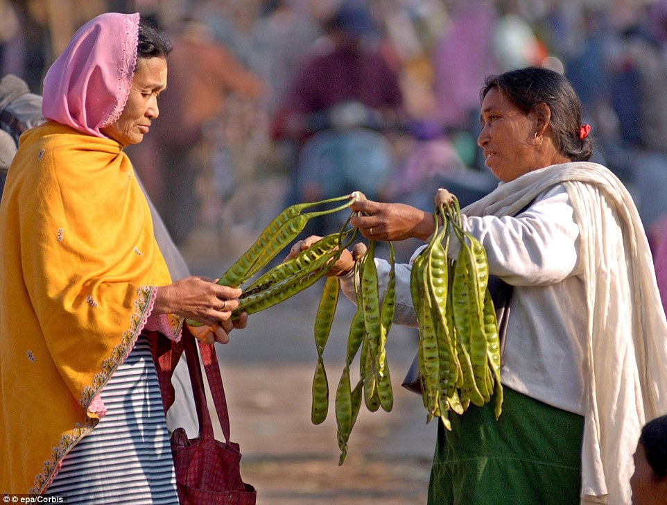 This market is said to reflect the empowerment of the women of Manipur. A woman vendor sells Yongchak (pictured)