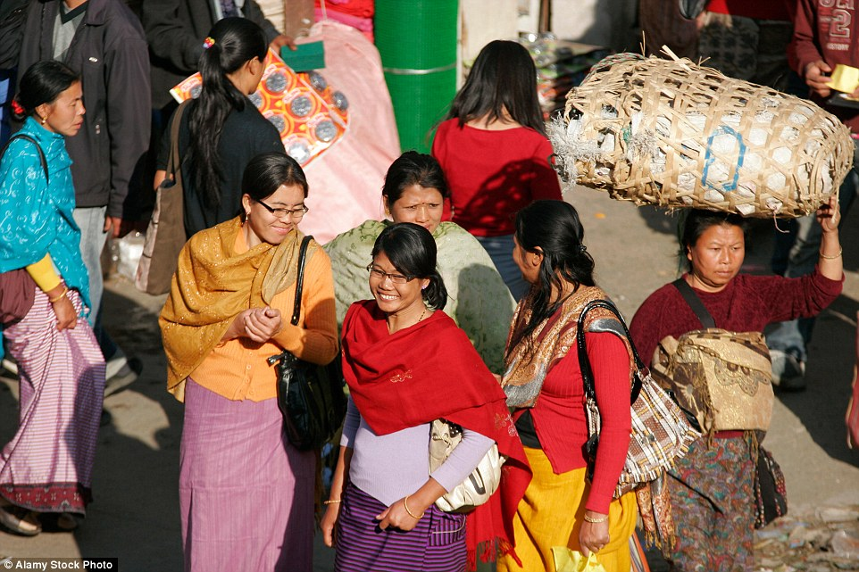 Female shoppers look delighted at the selection of traditional handcrafted items, modern clothing and local produce available to buy