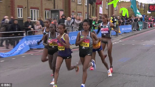 Just over three miles from the finish the lead group were approaching a water point when Sumgong tripped