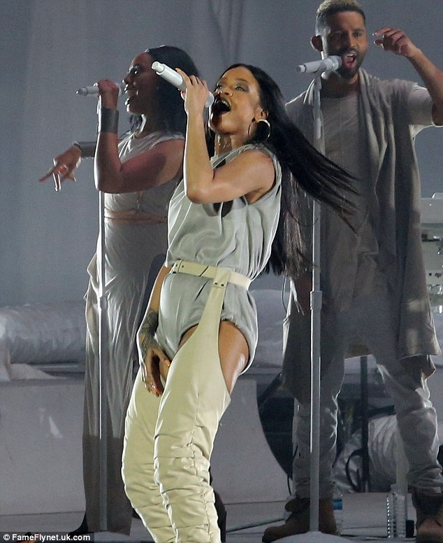 A different look:Another outfit was cool but not quite as flattering. The ex of Chris Brown and Drake had on a grey one piece that had rolled up legs