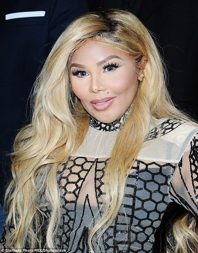 A month ago: Lil' Kim's face wasn't so 'pulled' during her outing at Brinks 5th Year Anniversary Party in Los Angeles on March 31