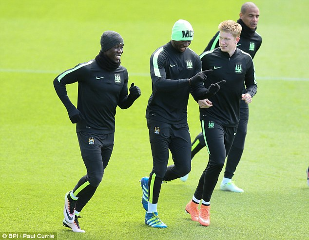 Eliaquim Mangala (centre) admits he's critical of his own performances and watches video clips of himself