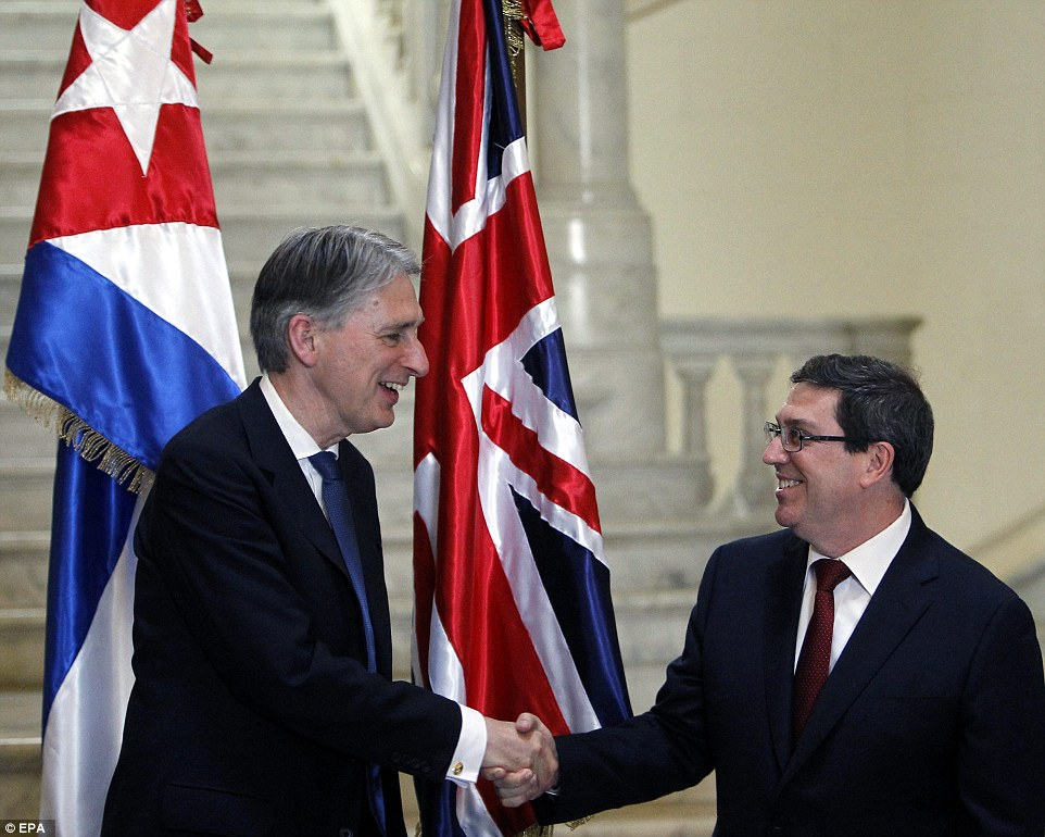 Philip Hammond today marked a new age in diplomatic relations with Cuba as he shook hands with his counterpart, Bruno Rodriguez Parrilla (right), becoming the first UK Foreign Minister to visit the communist nation since 1959