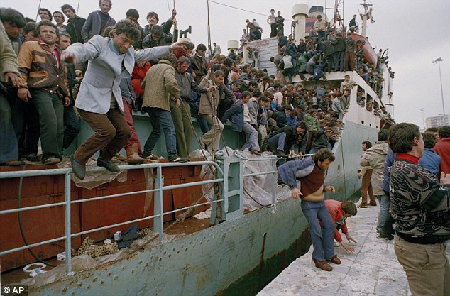 Desperate: Albanian refugees arrive in Italy in 1991, after the collapse of communism. How many more will come if Albania joins the EU?