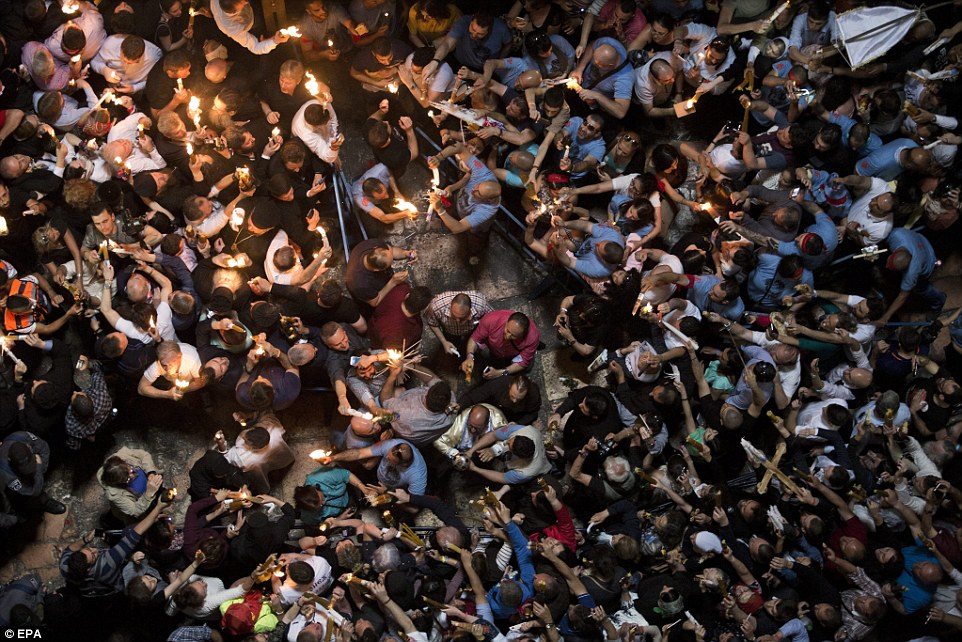 Pilgrims made their way to the Church of the Holy Sepulchre to light their candles, who pass on the flame to those outside in the street