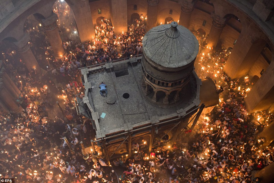 Thousands of Eastern Orthodox Christians visited the Tomb of Christ, pictured, as part of the miracle of the Holy Fire in Jerusalem