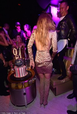 Sensual style: The slender stunner turned to reveal her miniscule dress was completely backless