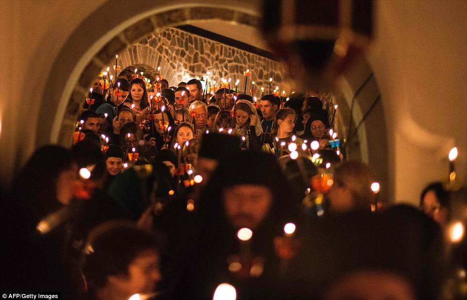 Macedonian Orthodox Christians hold candles as they take part in midnight Easter services at the Saint Jovan Bigorski monastery