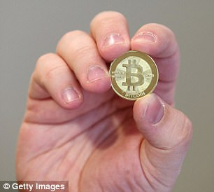 Bitcoins are lines of computer code that are digitally signed each time they travel from one owner to the next. Physical coin used as an illustration
