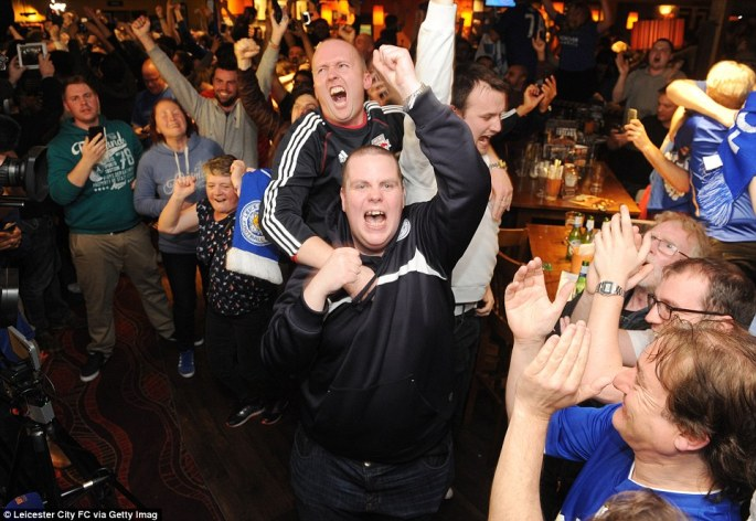 Leicester City fans celebrate their team becoming Premier League champions, as they watch Tottenham Hotspur play Chelsea, at The Local Hero pub on Freemans Common