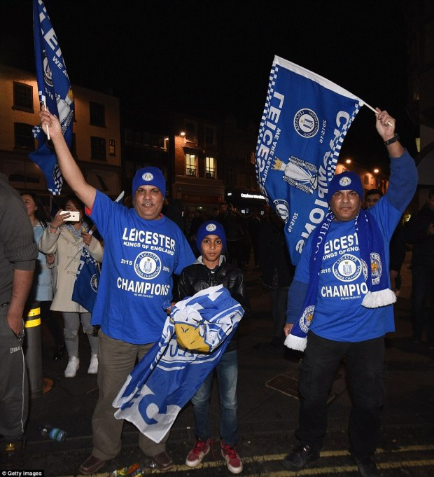 Leicester City fans celebrate as their team becomes Premier League champions after watching the Barclays Premier League between Chelsea and Tottenham Hotspur