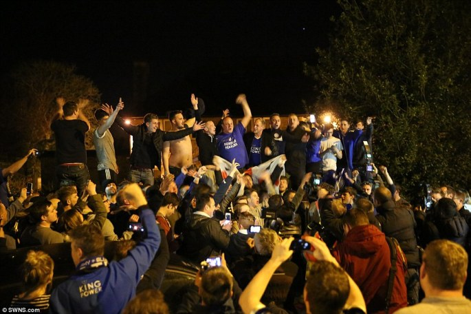 Crowds celebrate outside the £1million home of Jamie Vardy after Leicester City win the English Premier League for the first time