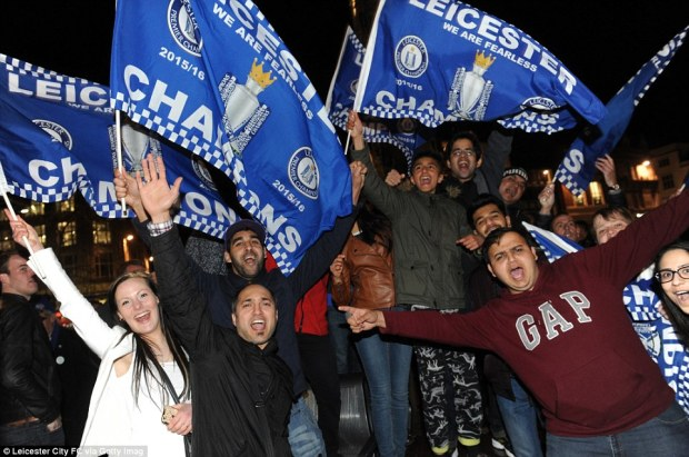 Leicester City fans celebrate their team becoming Premier League champions at The Clock Tower in the centre of Leicester