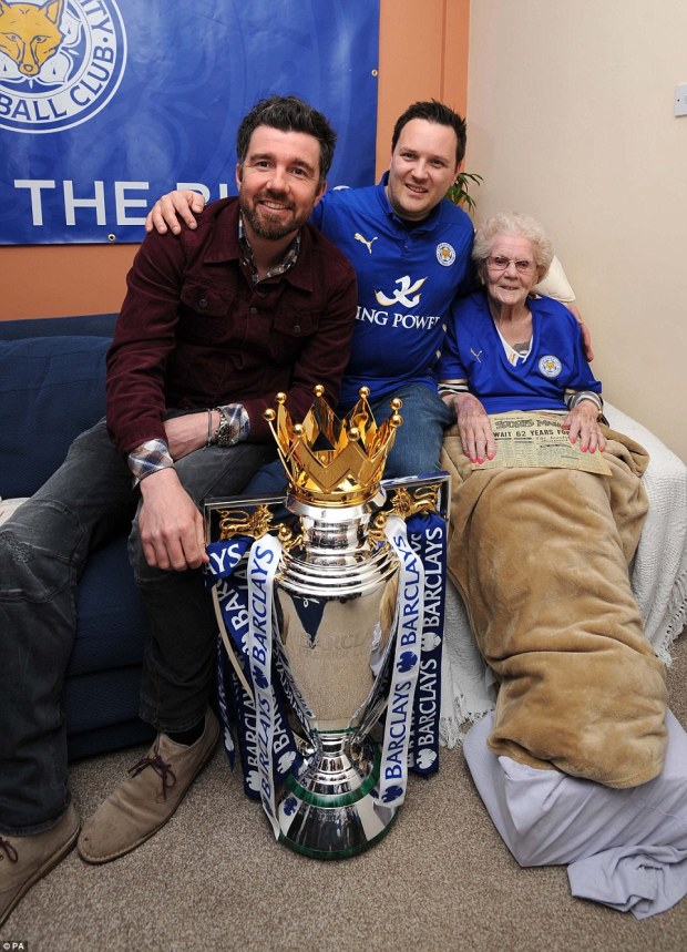 Steve Worthy (centre) with  former Leicester player Muzzy Izzet and grandmother Gladys Kenney, 97. Barclays is giving Worthy the opportunity to present the Barclays Premier League trophy to the champions on Saturday