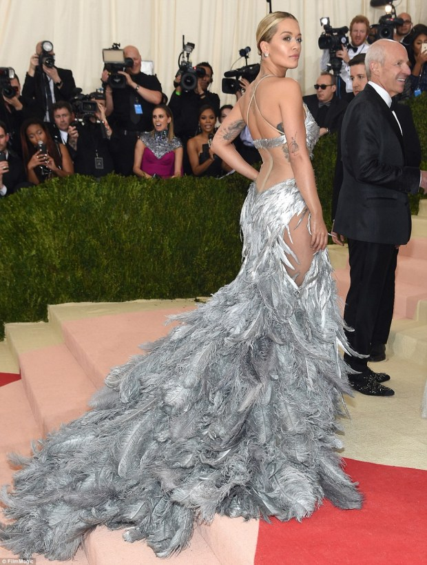 Curve-hugging: The 25-year-old pop star showed off the sheer paneling on the back of her gown