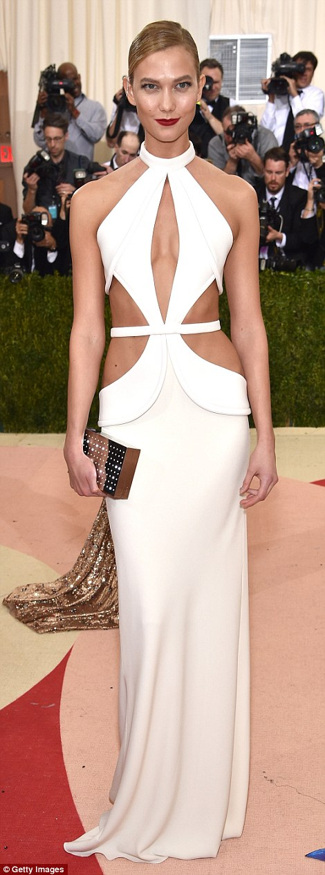 Halterneck hottie: Model Karlie Kloss was simply stunning in a cream cut-out gown