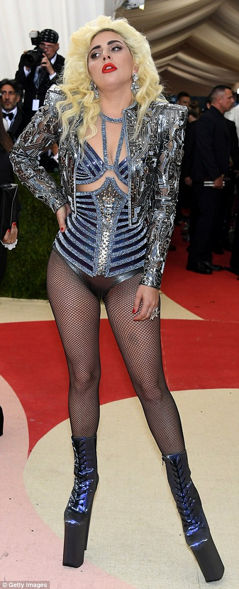 Zany: Lady Gaga didn't disappoint with her off the wall look consisting of fishnets, platforms and a metallic bodice and blazer